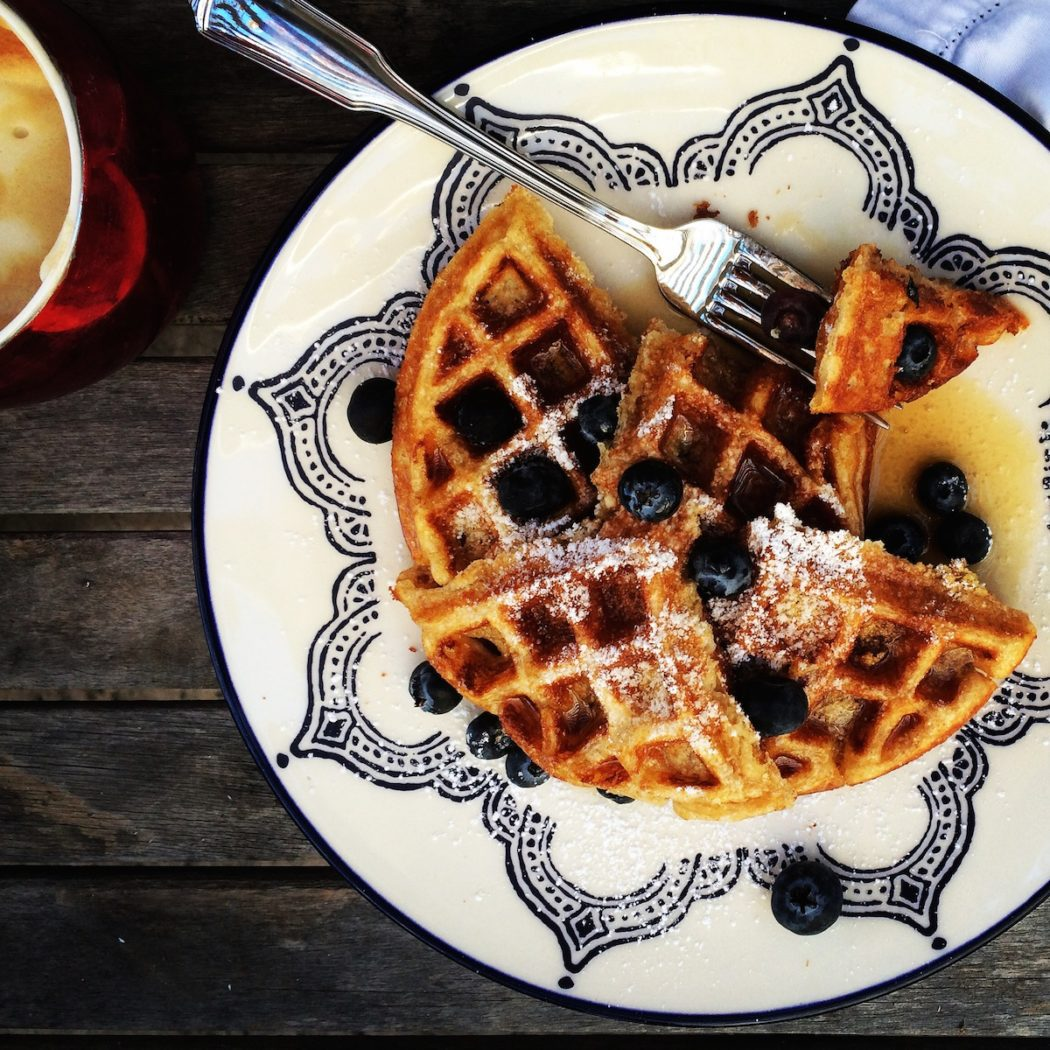Delicious buttermilk waffles with blueberries and maple syrup