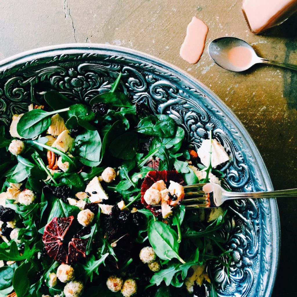 pecan-crusted goat cheese + braised chicken salad with blood orange tahini dressing