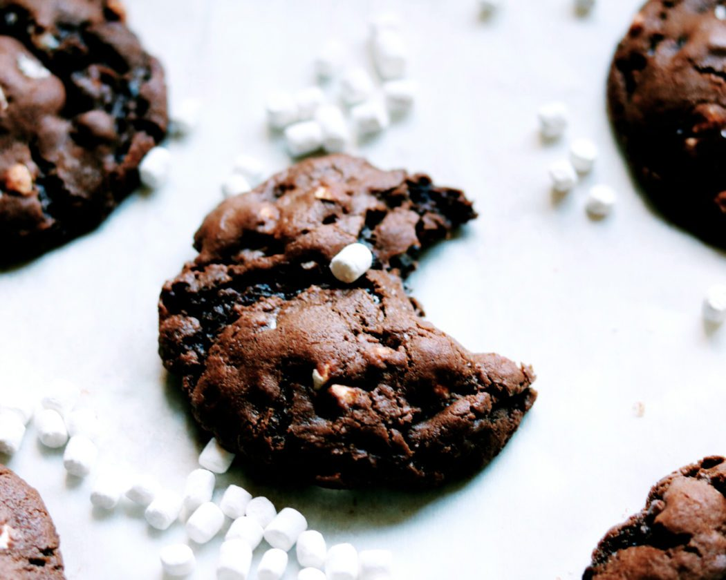A close up of a chocolate marshmallow cookie