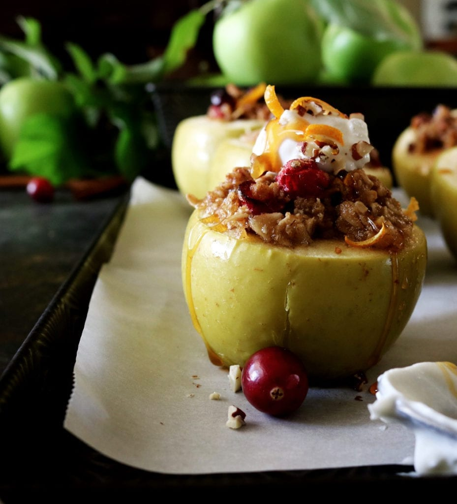 Cranberry Pecan Baked Apples | Recipe via DisplacedHousewife | cinnamon, tangerine zest, oatmeal, brown sugar, cranberries + pecans. Ready in under an hour! The perfect dessert. YUM!