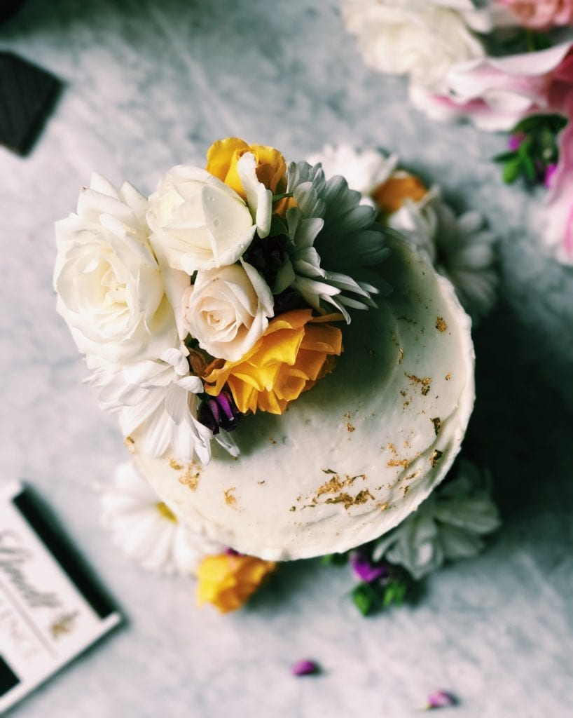 Gilded Dark Chocolate Cake With Champagne Buttermilk | Recipe via DisplacedHousewife | This all sounds fancy, and it's for a fancy occasion, but we break it down into easy steps...including some make ahead stuff. A rich, buttermilk-driven chocolate cake is coated in a balanced champagne buttercream. Gold leaf is placed about and flowers brighten up the whole mood. Yep. It's Awards Season. Time to bust our your spanx and sequins. And this cake. xo