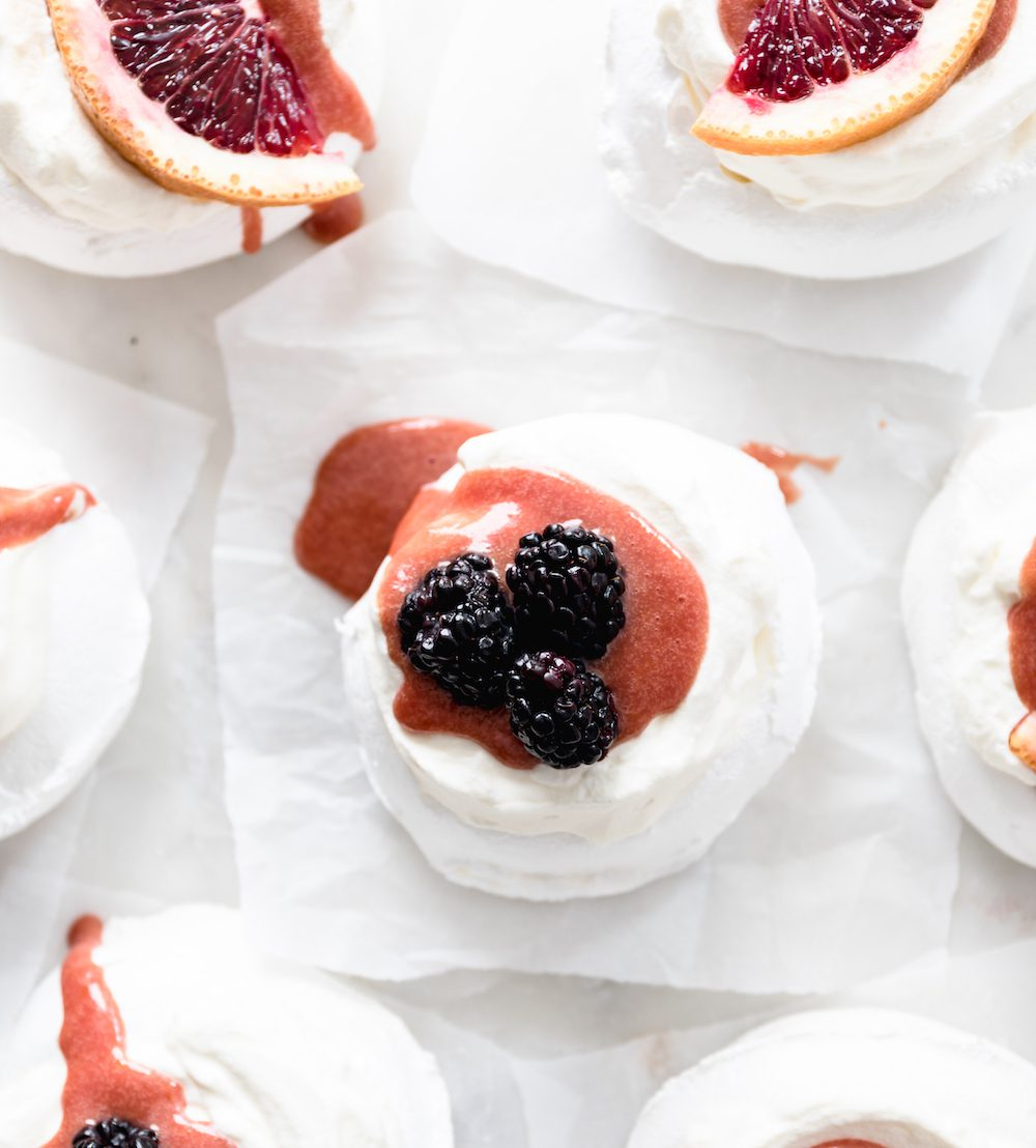 A bunch of meringues with blood orange curd