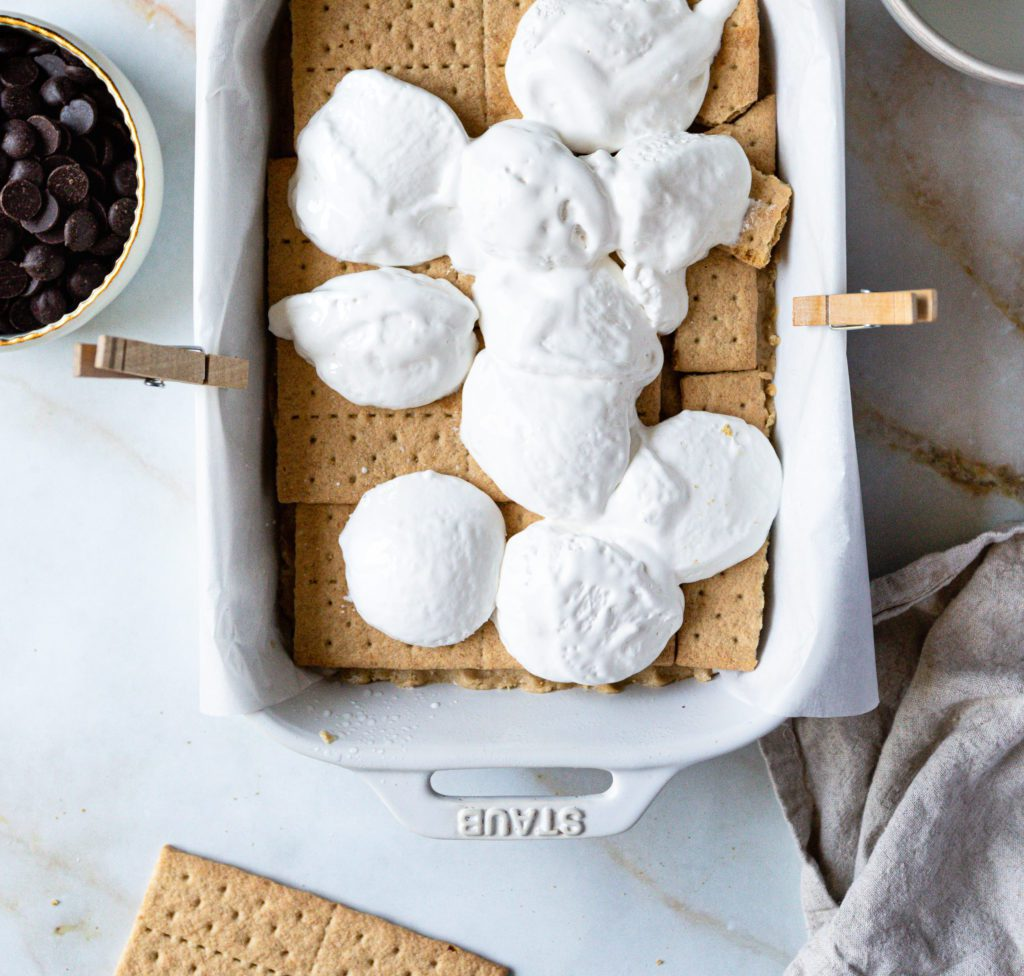 drops of marshmallow fluff on top of graham crackers